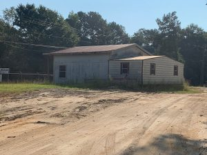 7 ACRES WITH AN OFFICE AND 2 LARGE SHOPS